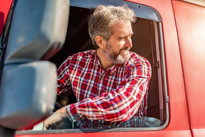 truck driver looking out semi window